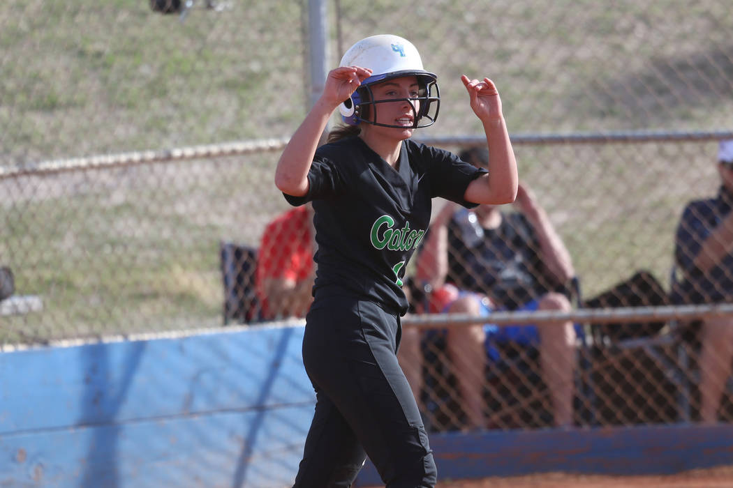Green Valley's Landree Galvin (4) celebrates after running home for a run against Foothill in t ...
