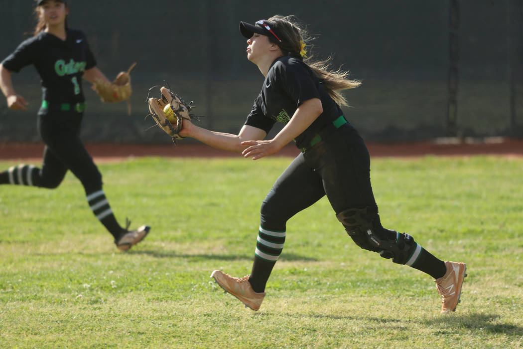 Green Valley's Cinthia Garcia (13) makes a catch in the outfield for an out against Foothill in ...