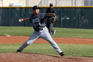 Silverado's Angel Garcia delivers a pitch against Cimarron-Memorial in the third inning of thei ...