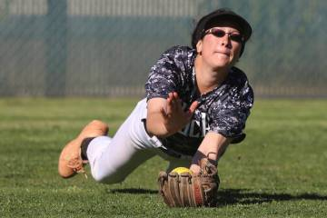 Desert Oasis' Makayla Rickard makes a diving catch against Liberty in a softball game at Desert ...