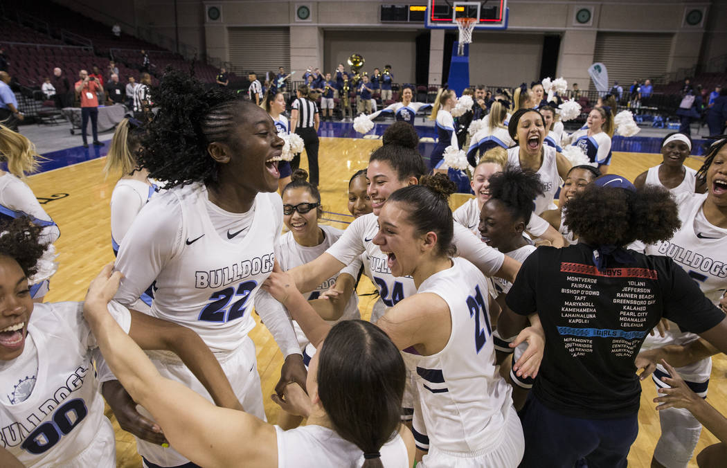 Centennial's girls basketball team celebrates after beating Bishop Gorman, 78-47 to win the Cla ...