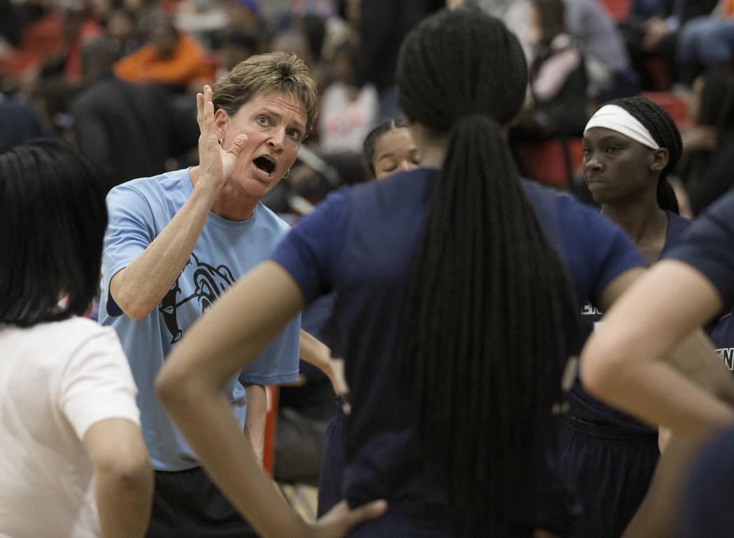 Centennial head coach Karen Weitz tries to fire up her team in the second quarter during a time ...