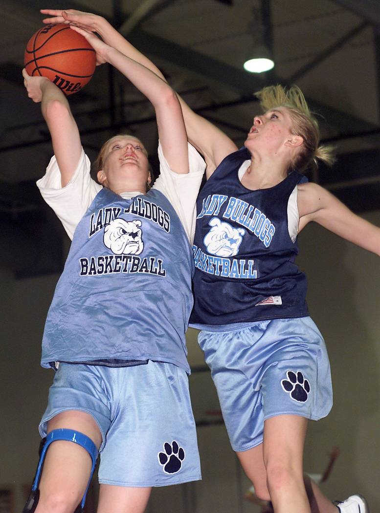 Centennial High School center Heather Thorson, left, goes up for a shot against forward/guard D ...
