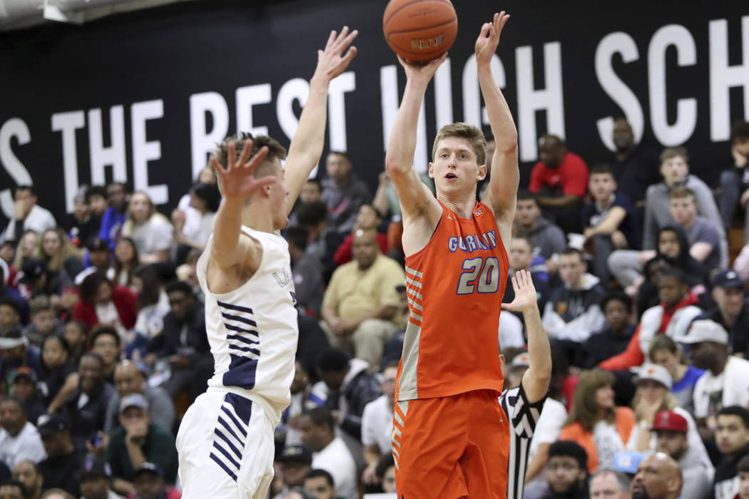 Bishop Gorman's Noah Taitz (20) shoots over La Lumiere's Paxson Wojcik in a Boys Quarterfinal g ...
