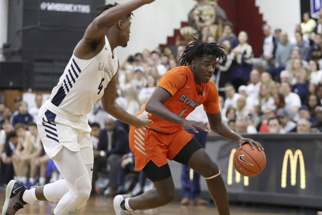 Bishop Gorman's Will McClendon (1) handles the ball against La Lumiere's Gerald Drumgoole in a ...