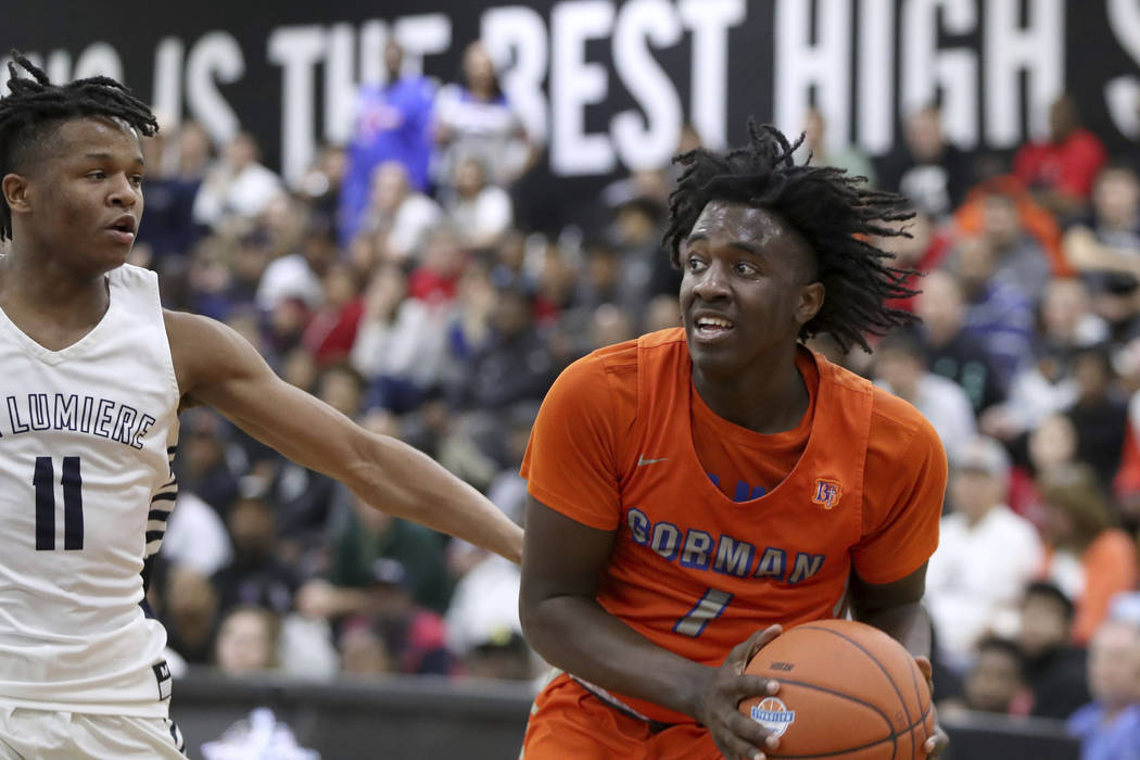 Bishop Gorman's Will McClendon #1 in action against La Lumiere's Wendell Green (11) in a Boys Q ...