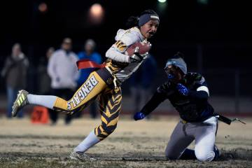 Bonanza's Ashley Vasquez (75) avoids a tackle from Green Valley's Anna Marie Arce during Class ...