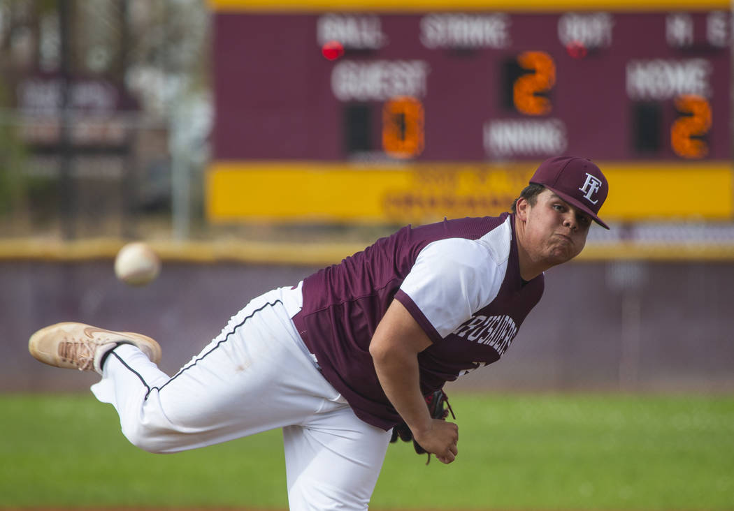 Faith Lutheran's pitcher Christian Dijkman (21) sends another ball towards the plate versus Pal ...