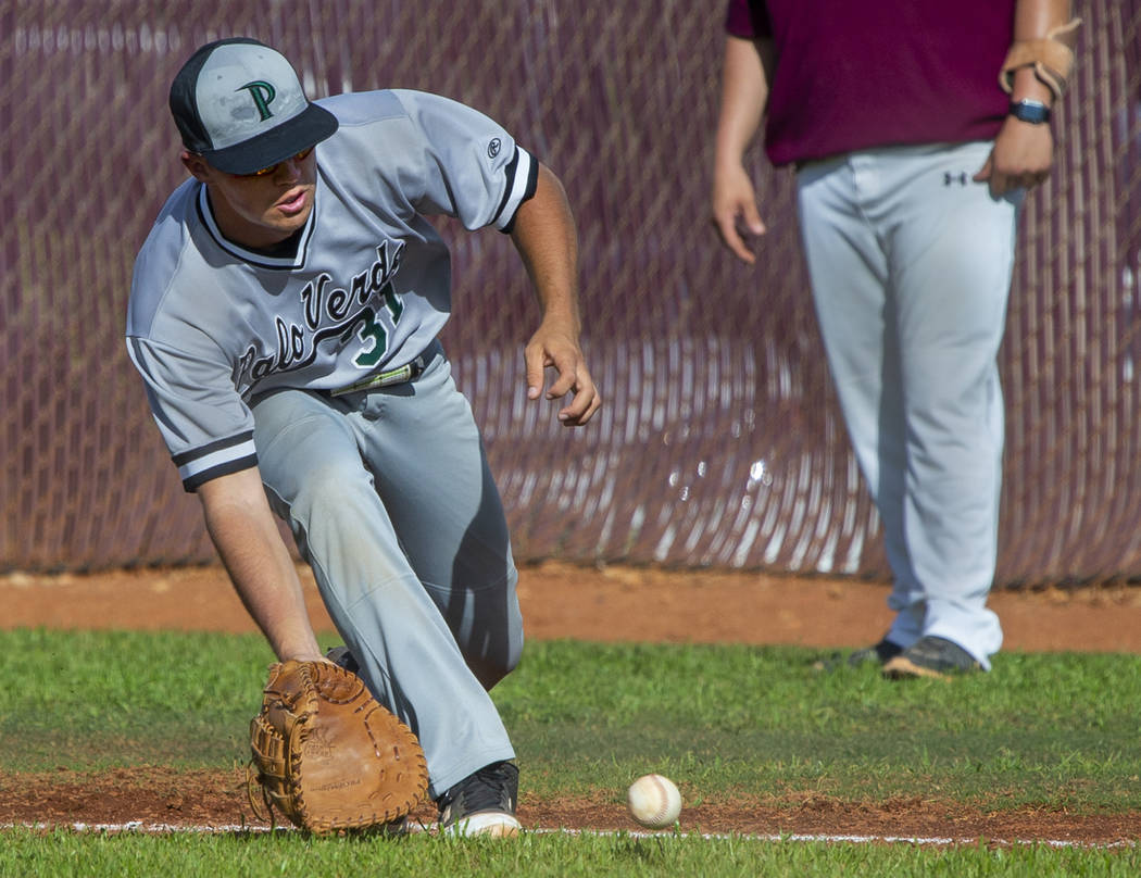 Palo Verde's Austin Raleigh (31) looks to a grounder from a Faith Lutheran batter during their ...