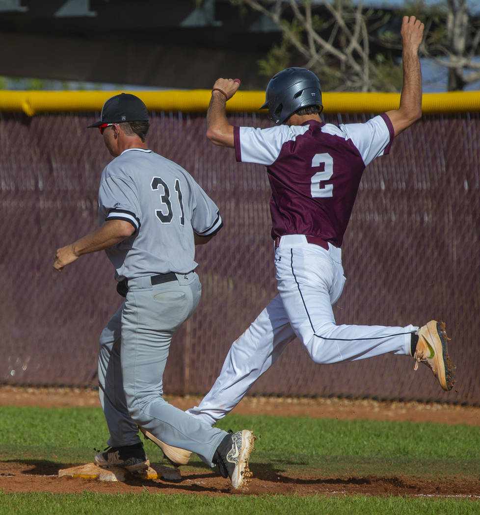 Palo Verde's Austin Raleigh (31) gets back to tag first base just ahead of Faith Lutheran runne ...