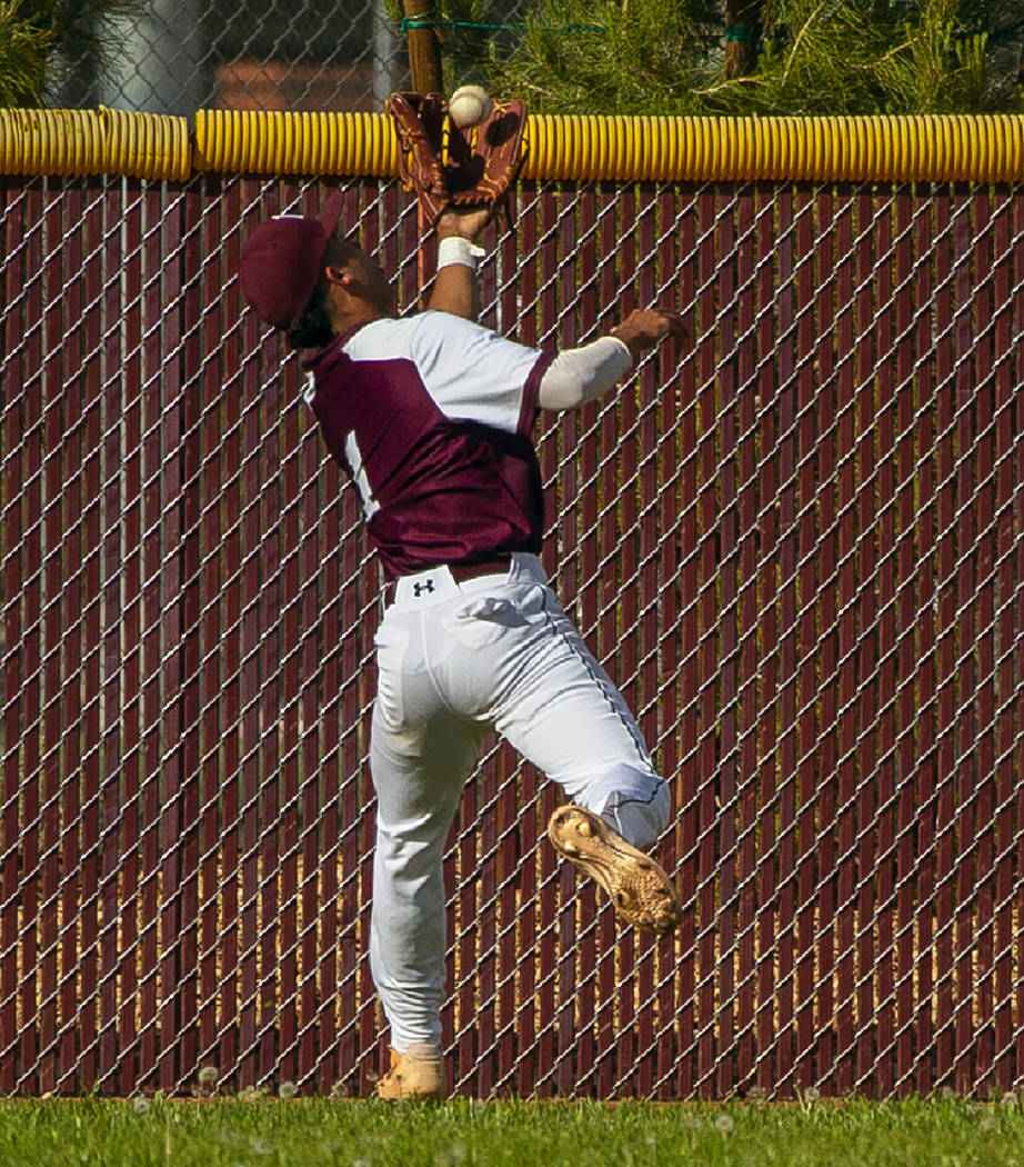 Faith Lutheran's Dylan Schafer (1) goes deep into center field for a catch from a Palo Verde ba ...