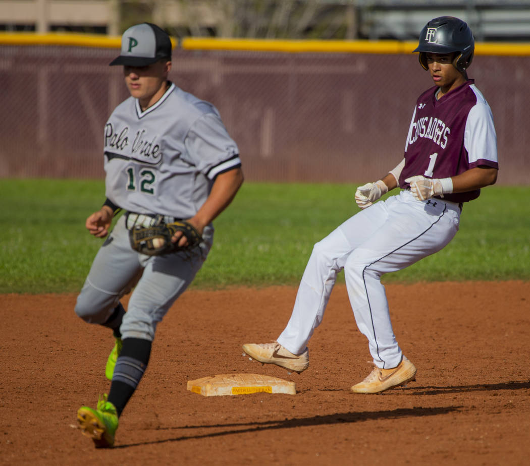 Palo Verde's (12) has to step off the bag for a wild throw as Faith Lutheran's Dylan Schafer (1 ...