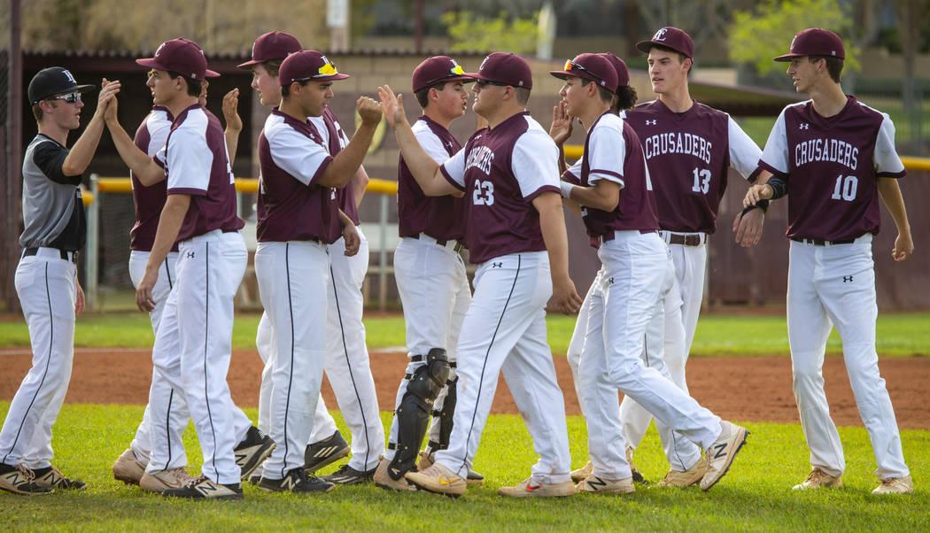 Faith Lutheran players celebrate their win over Palo Verde during their high school baseball ga ...