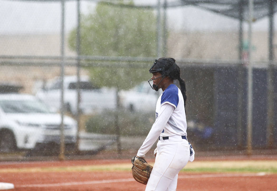 Shadow Ridge's Jasmine Martin (8) gets ready to pitch in the first inning of a softball game as ...