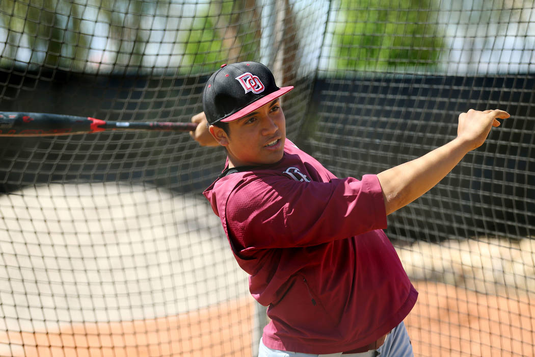 Desert Oasis senior Aaron Roberts, 18, hits the ball during a team practice at Desert Oasis Hig ...