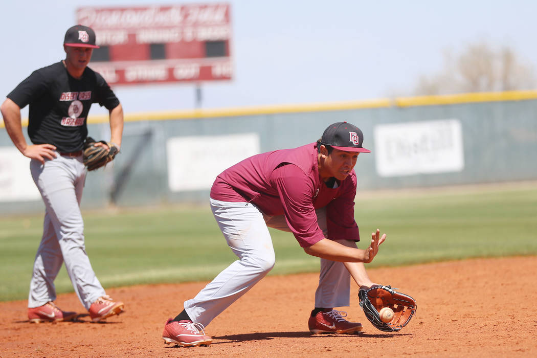 Desert Oasis senior Aaron Roberts, 18, catches a ground ball during a team practice at Desert O ...