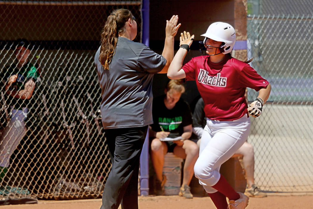 Desert Oasis Holly Severance (4) rounds the bases after a three-run homer against Rancho in the ...