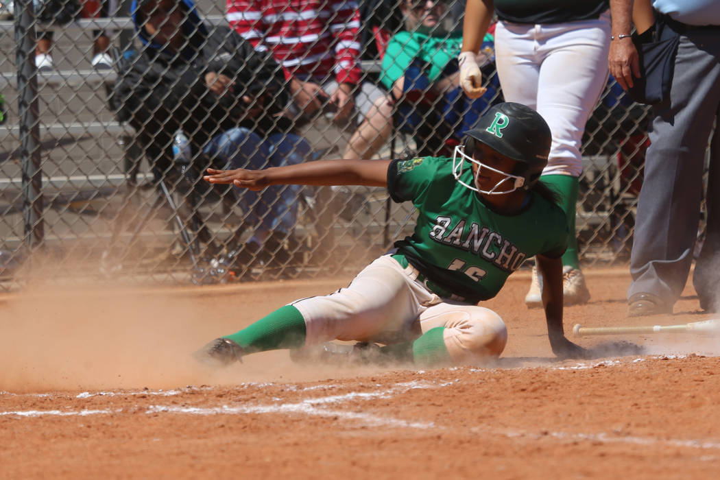 Rancho's Anaiya Irick (16) slides home for a run against Desert Oasis in the softball game at D ...
