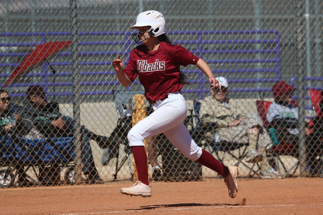 Desert Oasis Ruby Martinez (10) runs home for a run against Rancho in the softball game at Dura ...