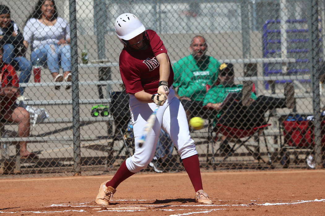 Desert Oasis Holly Severance (4) hits a two-run double against Rancho in the softball game at D ...