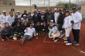 Members of the Sierra Vista and Schurr (California) softball teams pose for a group photo after ...