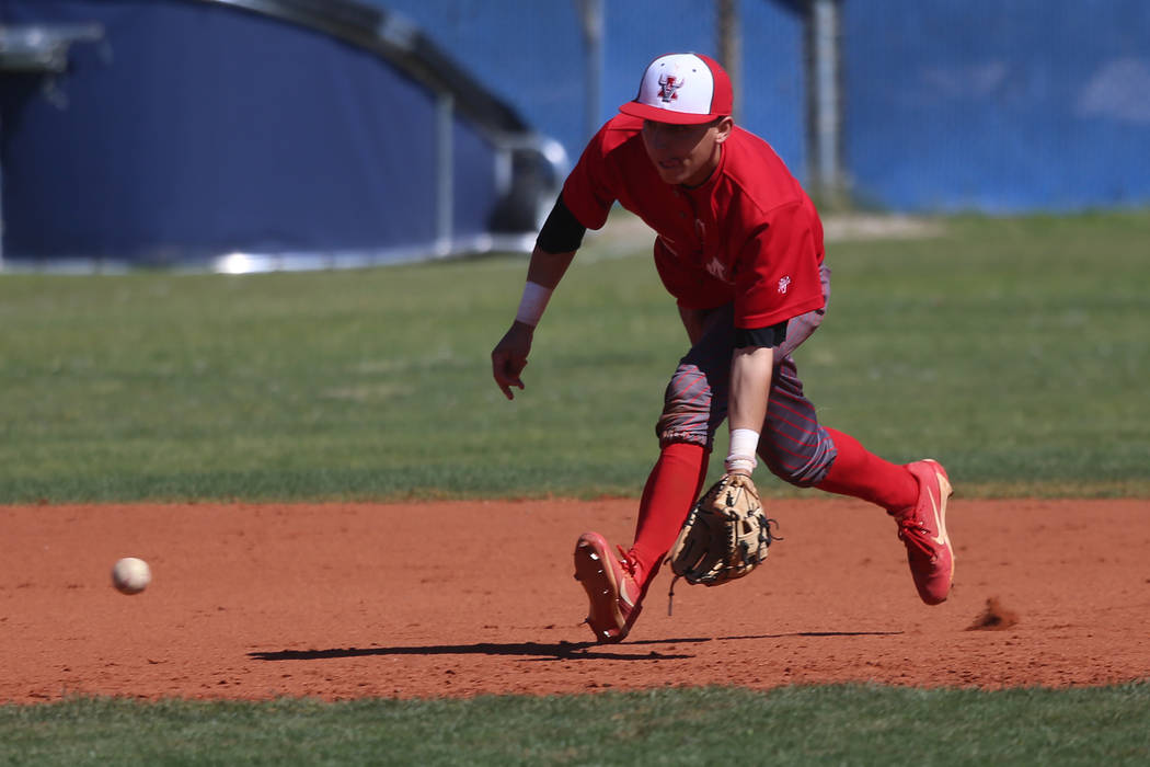 Arbor View's Nicholas Cornman (2) picks up a ground ball before throwing to first base for an o ...