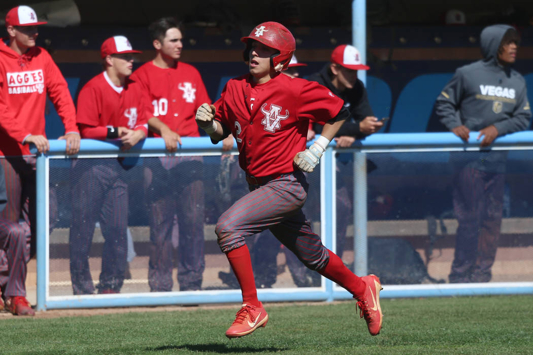 Arbor View's Nicholas Cornman (2) runs home for a score against Carson in the baseball game at ...