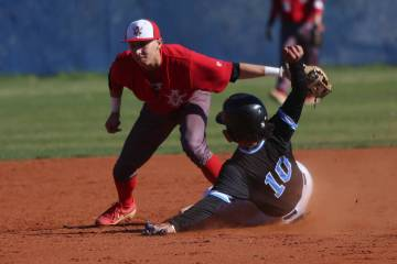 Arbor View's Nicholas Cornman (2) tags out Carson's Steven Franco (10) in the baseball game at ...