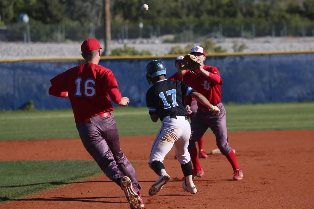 Arbor View's Jacob Scioli (16) throws the ball to Brad Stone (4) to tag out Carson's Nathan Max ...