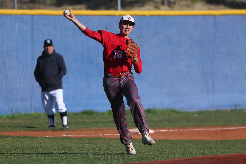 Arbor View's Dillon Jones (10) throws to first base for an out against Carson in the baseball g ...