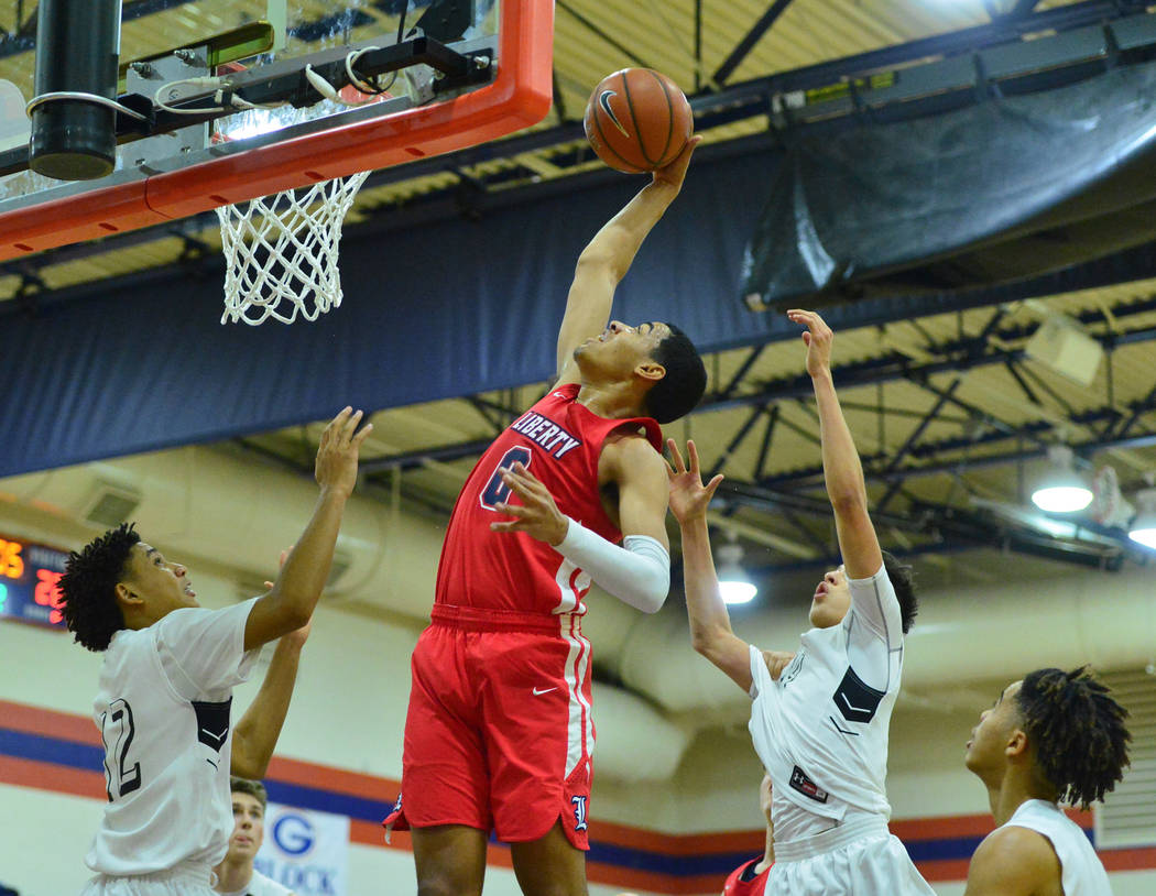 Liberty's Julian Strawther (0) rebounds the ball in the second quarter of the game between Libe ...