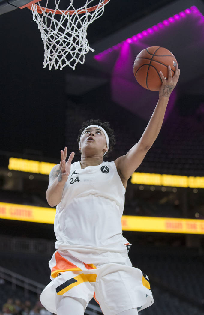 Kierstan Bell (24) drives to the rim in the fourth quarter during the Jordan Brand Classic All- ...