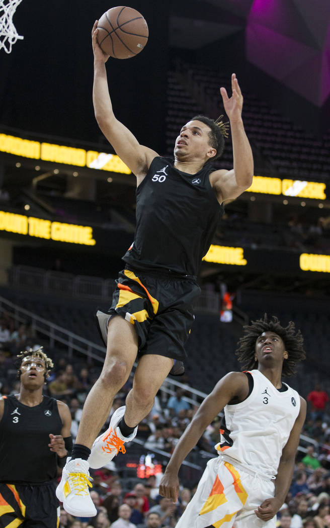 Cole Anthony (50) slices to the rim past Tyrese Maxey (3) in the first half during the Jordan B ...