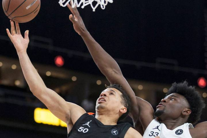 Cole Anthony (50) drives past Isaiah Stewart (33) in the first half during the Jordan Brand Cla ...