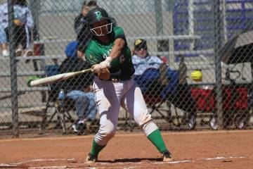 Rancho's Liliana Gutierrez (6) hits the ball for a solo homer against Desert Oasis in the softb ...