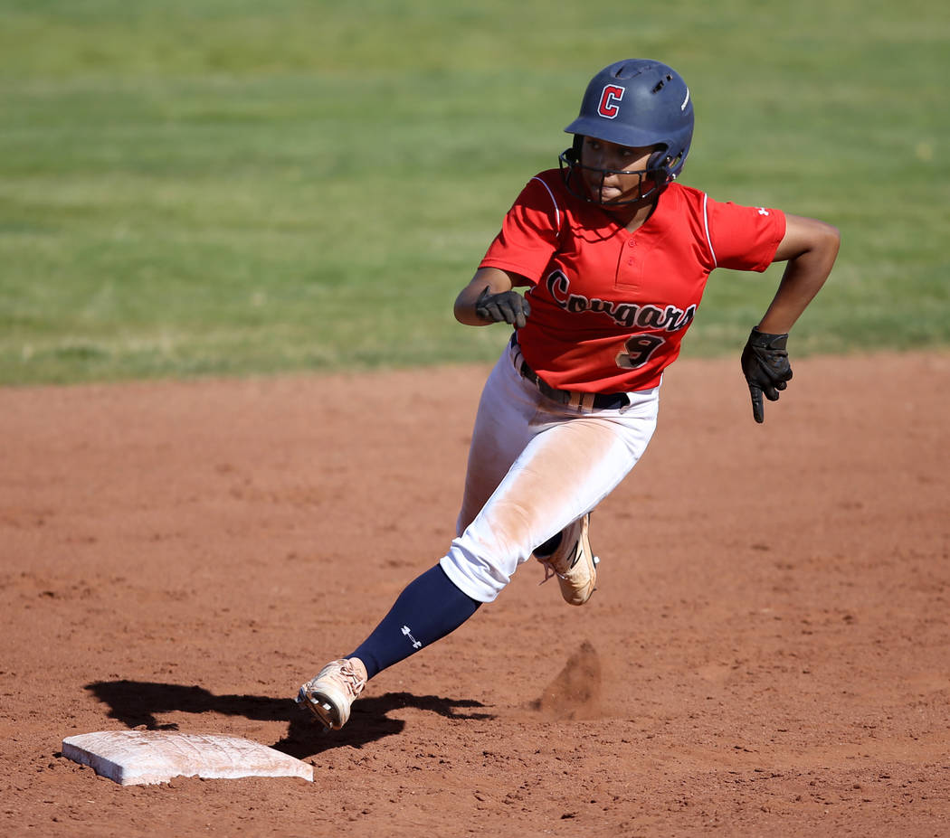 Coronado's Kaila Angel (9) rounds second base after getting a hit off Basic in the third inning ...