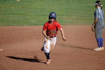 Coronado shortstop Paige Sinicki (12) heads for third base during a softball game against Basic ...