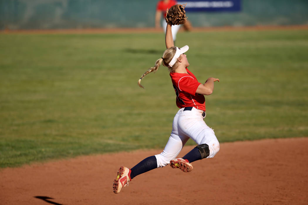 Coronado shortstop Paige Sinicki (12) jumps for a Basic line drive during their softball game a ...