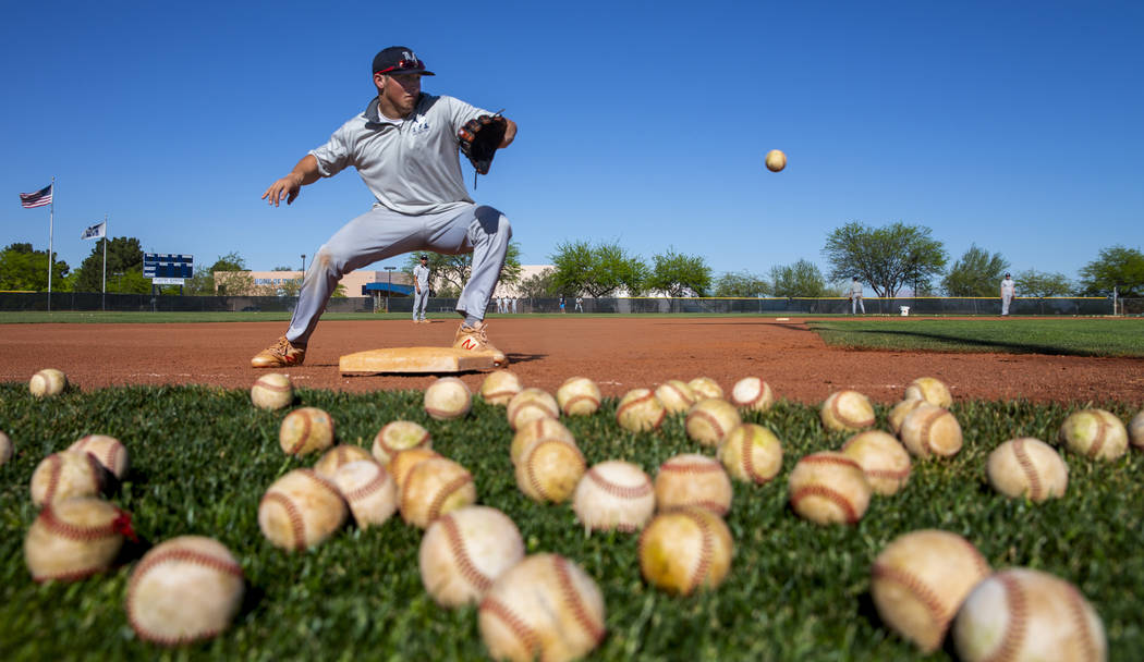 The Meadows School third baseman Sam Kaplan looks in a high ground ball during fielding practi ...