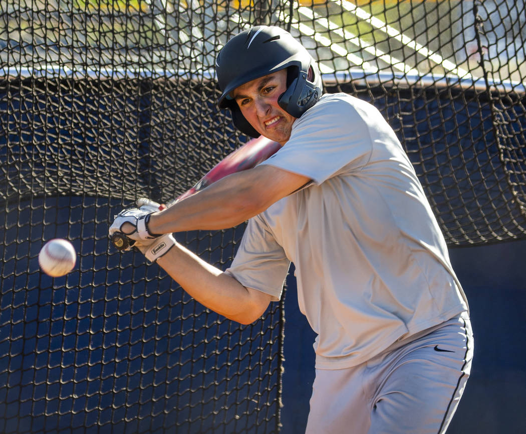 The Meadows School third baseman Sam Kaplan eyes a pitch during hitting practice, he will play ...