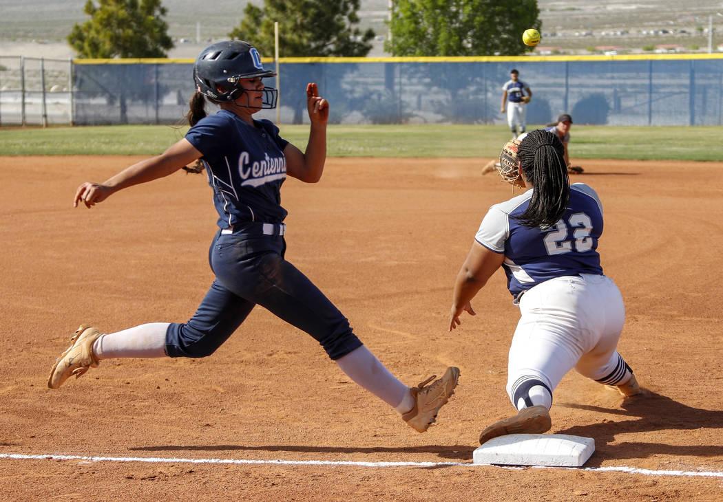 Centennial outfielder Abby Hanley (12) runs safely into first base as the ball is thrown to Sha ...