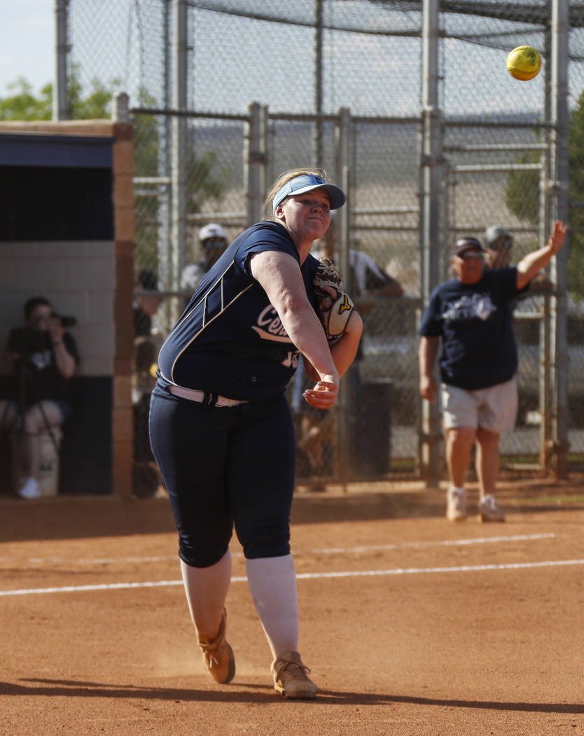 Centennial pitcher Amanda Sink (18) throws the ball to first base in the fourth inning of their ...