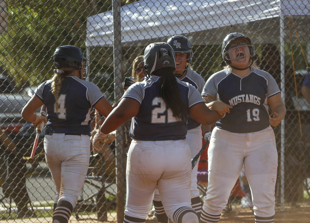 Shadow Ridge players cheers after catcher Shea Clements (4) scores the first run of the game in ...