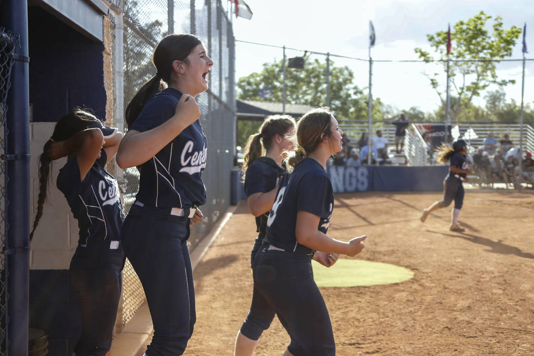 Centennial plays cheer on their teammates in the seventh inning of their softball game at Shado ...