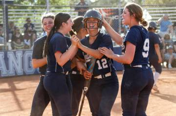 Centennial's Abby Hanley (12) is congratulated by her teammates after scoring a run in the seve ...