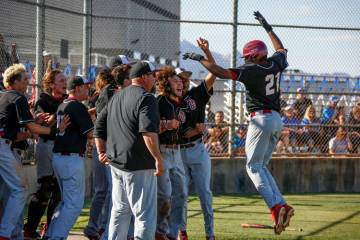 Desert Oasis pitcher Jacob Walsh (21) is congratulated by his teammates after hitting a home ru ...