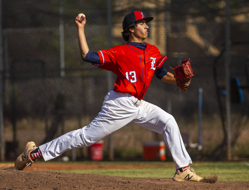 Liberty pitcher Devin Contreras (13) sends another throw towards the plate versus Spring Valley ...