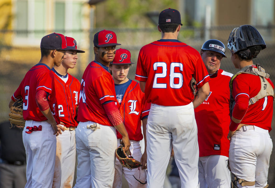 Liberty players come together with head coach Rich Ebarb for a time out versus Spring Valley du ...