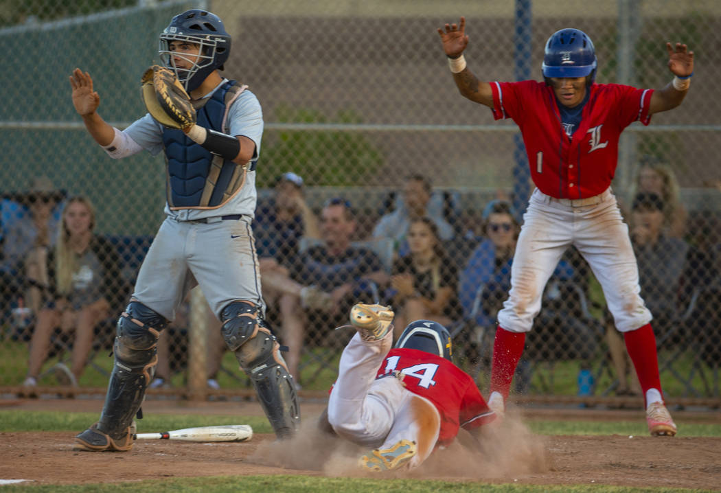 Spring Valley catcher Ryan Steinhauer (24) waits for a late throw as Liberty's Ryan Towers (14) ...