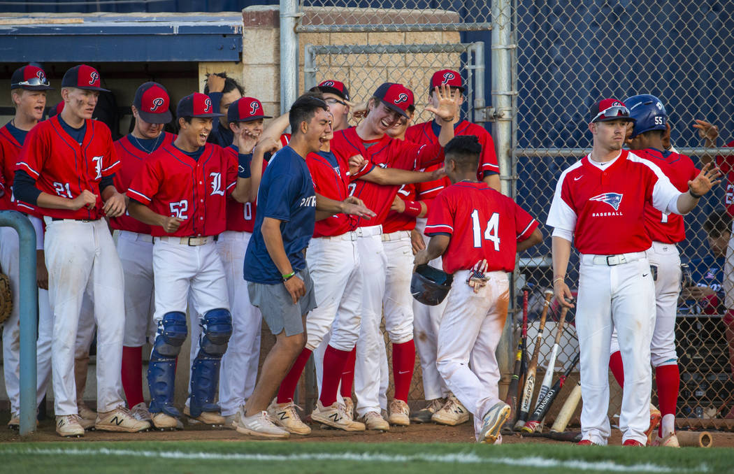 Liberty players celebrate a late-game score by teammate Ryan Towers (14) during the first round ...